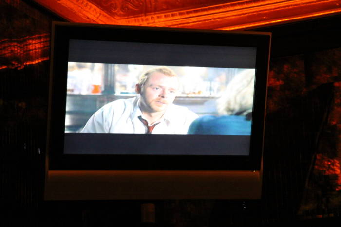 Donny Dirk's Zombie Den  - 'Shaun of the Dead' playing on one of the flat-screen TVs above the bar.
